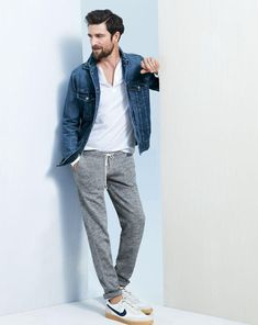 Shop this look for $89: http://lookastic.com/men/looks/blue-denim-jacket-and-white-v-neck-t-shirt-and-grey-sweatpants-and-white-low-top-sneakers/1149 — Blue Denim Jacket — White V-neck T-shirt — Grey Sweatpants — White Low Top Sneakers