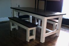 """Hey, hey.. Look what came out of the shop this morning! A reclaimed wood farmhouse dining table and two benches. Top is stained a dark walnut, table and bench bases are distressed white. Table is 70"""" long and 38"""" wide. Benches are 4 feet long. $600 for Table and two benches. Can be purchased separately, and custom orders are always welcome."""
