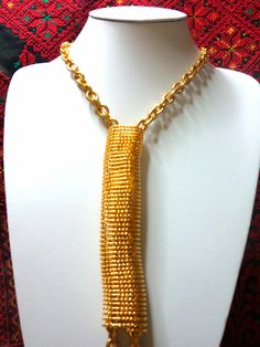 Gold chunky chain with spiral tube pendant