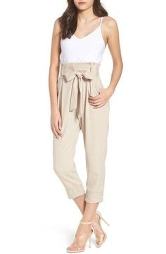 719e3bdb17f A jumpsuit that pairs a white cami and cropped trousers with a paperbag  waist gives you