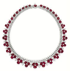 RUBY AND DIAMOND 'FLORAL' NECKLACE.  Of floral motif design, set with graduated oval and cushion-shaped rubies together weighing approximately 112.41 carats, to a necklace set with baguette and brilliant-cut diamonds, embellished by pear-shaped and brilliant-cut diamonds, the diamonds together weighing approximately 41.45 carats, mounted in 18 karat white gold, length approximately 430mm.