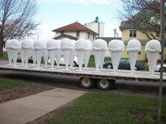 All 31 giant ice cream cones and one cow sculpture have arrived in Le Mars, Iowa, and are ready for paint jobs.  The 6 foot tall fiberglass ice cream cones have been delivered to the homes of artists throughout Siouxland who will paint different designs on each cone.  The cones will then be placed around the community in front of businesses and at other sites.