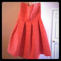 Adorable strapless dress never worn! This is adorable!! It's a muted orange color! Francesca's Collections Dresses