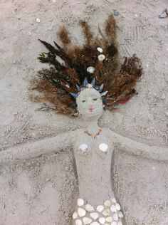 I made this mermaid on Sanibel Isle , zoom in to see shell jewelry, apple murex , pen oyster shards, coquinas and scallops