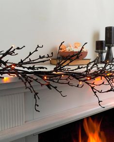 Create an elevated Halloween scene with handcrafted branches dipped in black glitter. Wreaths And Garlands, Outdoor Wreaths, Tree Decorations, Christmas Decorations, Holiday Decorating, Orange Led Lights, Slim Tree, Balsam Hill, Halloween Scene