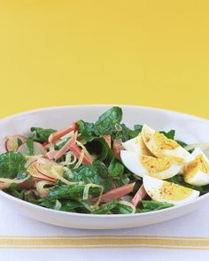 With the addition of ham and hard-cooked eggs, this simple spinach salad becomes a hearty and delicious full meal.