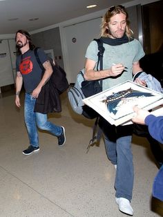 Dave Grohl Photos - Dave Grohl and Taylor Hawkins at LAX - Zimbio