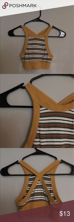 UO / striped crop top Super cute yellow red white and black striped crop top with crossed accent in the back! sooo cute but i don't wear it enough!! NO TRADES Urban Outfitters Tops Crop Tops
