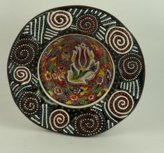 * Name: 20 cm Çini ceramic Relief Bowl   * Product description : Turkish hand made product. It is unique. * Size/Dimensions/Weight: diameter: 20 cm, depth: 6.5 cm * Materials utilised: It is çini ceramic. Non toxic colors. * Production method: First it is baked in 900c degree. After baking, it is hand painted with çini colors than baked again. You can order this pin from: https://www.etsy.com/shop/BasarCansel?section_id=16403083&ref=shopsection_leftnav_1 * 39.99 USD