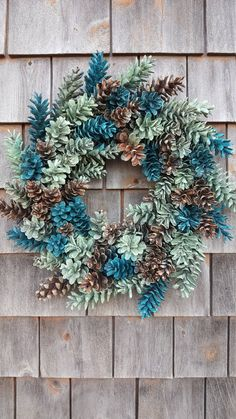 Ocean wreath, made in Maine, Ocean theme, cottage wreath, cottage This one is a.Maine Pinecone Wreath in shades of The Sea by scarletsmile on EtsySee the video and tutorial to make a gorgeous wreath by using spray painted pinecones with your favorite Nature Crafts, Fall Crafts, Holiday Crafts, Christmas Wreaths, Christmas Crafts, Christmas Decorations, Holiday Decor, Christmas Christmas, Primitive Christmas