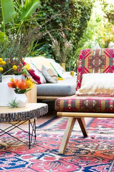 falling for the gorgeous rugs, layers of pattern + natural accents