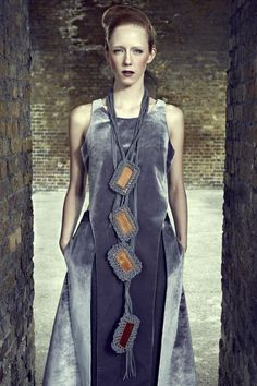 "CJ Yao.  She uses wood, string and fringe to create complex, exaggerated pieces in her ""Wood Be"" collection."