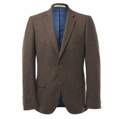 A beautifully tailored 3-piece tweed suit. The fabric is a fine earthy brown salt & pepper. An ideal suit for a wedding or special occasion. The style is tailored. Jacket features include - 2 buttons, contrasting collar melton, internal pockets, straight pockets, 4 button cuff and side vents  Trouser features include - belt loops and a zip fly Waistcoat features include -  2 jett pockets and lapel