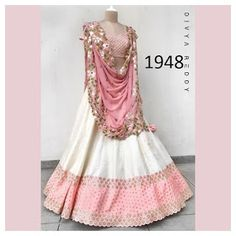Off White And Pink Colour Taffeta Silk Fabric Party Wear Lehenga Choli Comes with matching blouse. This Lehenga Choli Is crafted with Embroidery This Lehenga Choli Comes with Unstitched Blouse Which C. Party Wear Indian Dresses, Indian Gowns Dresses, Indian Bridal Outfits, Party Wear Lehenga, Indian Fashion Dresses, Dress Indian Style, Indian Designer Outfits, Indian Wear, Wedding Dresses