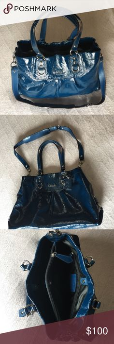 Blue Coach Handbag A gorgeous navy/aqua blue patent leather authentic coach purse with silver hardware. There are two straps and one long removable strap. The bag is spacious, has two sections with magnetic clasps separated by a third zippered section. Fits a ton of stuff, great tote for everyday but nice enough for a special occasion. Gently worn but well preserved and in great condition, looks brand new! Wipes clean, it is essentially impossible to dirty this bag! Coach Bags Totes