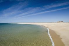 Ilha Deserta, Algarve, Portugal considered one of  The 9 Best Nude Beaches in the World by Oyster.com - February 26, 2015 -  Lara Grant   Just off the coast of Faro, Ilha Deserta (Deserted Island) is an uninhabited island about five miles long. It costs around 10 Euros to take the 30-minute boat ride to the island. The water is clear and warm, there's ample space to lounge about sans suit, and there's one well-regarded restaurant on the island.