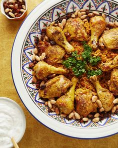 Considered the national dish of Saudi Arabia, this spiced chicken-and-rice dinner couldn't have a more beautiful presentation -- it's served with fried almonds and raisins, parsley sprigs, and a citrusy yogurt sauce. Kabsa Recipe Chicken, Chicken Recipes, Chicken Spices, How To Cook Chicken, Arabian Food, Party Dishes, Eastern Cuisine, Middle Eastern Recipes, The Best