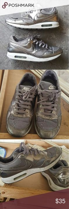 Nike sneakers Metallic Nike air (max?) Sneakers. Idk much about shoes if they're cool I'll wear em. Not in the greatest condition. Some scuffing & creasing throughout. There's also a hole shown in pic 4 not visible when worn. The insoles are lifting up but thats easily fixed / replaced. No size but I'm a 7 and they fit nicely. Could fit a 7.5 also.  Selling as is #nike #airmax #nikes #vintage #kawaii Nike Shoes Sneakers