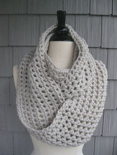 Cowl neck and infinity scarves are hot again for the third winter in a row, and we love these hand-knit versions from Laura in Fords, NJ (sold online in her Etsy shop, Babyarns) starting at $39.