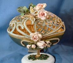A Fabergé egg is a jeweled egg made by the House of Fabergé from 1885 to 1917. Most were miniature eggs that were popular gifts at Easter. They were worn on a neck chain either singly or in groups....
