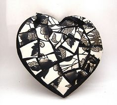 """This heart is made of broken dishes, showing the fragments of Grace. She is not one whole person; she may have two personalities. Also, this compares with when """"Aunt Pauline's teapot fell off onto the floor, and the teapot broke"""" (122)."""