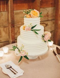 Floral Wedding Cakes A three-tiered white wedding cake decorated with garden roses, ranunculus, and greenery, created by Grandma Miller's Pies and Pastries. - Pretty blooms are the perfect accessory for a springtime confection. Wedding Cake Photos, Floral Wedding Cakes, Wedding Cakes With Flowers, Beautiful Wedding Cakes, Floral Cake, Beautiful Cakes, Wedding Cake Decorations, Wedding Cake Toppers, Wedding Decor