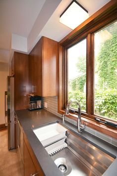 "Crisp, modern kitchen with stained oak, Caeserstone ""Raven"" countertops, Kohler ""Prolific"" sink and ""Sensate"" faucet."