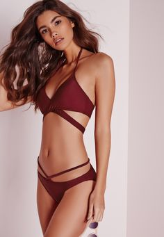 Who's ready to wow the crowd? Well, with this totally fierce cross strap bikini set you'll be sure yo turn heads. With cross detailing to the bottoms and sexy wrap round top, this beaut is the perfect piece to take with you on your hols. Te...