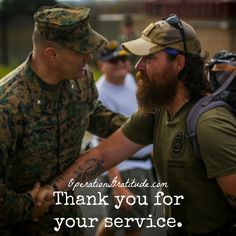 Lt. Col. Bryan Greene, the battalion commander for 2nd Battalion, 4th Marine Regiment welcomes Jon Hancock to Marine Corps Base Camp Pendleton, Calif., Dec. 11, 2016. Hancock walked across the country from Maryland to California honoring his fallen brother and raising awareness for veterans. 2nd Battalion, 4th Marine Regiment held a ceremony honoring his journey. (U.S. Marine Corps photo by Lance Cpl. Frank Cordoba. Used with permission.)