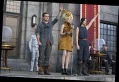 Peeta's outfit is just perf on him. Katniss looks great as always and Effie is just, well just effie