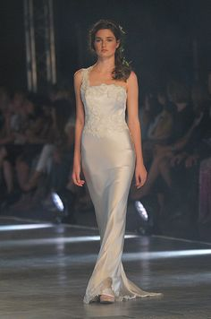 This silk, one should wedding dress is form fitting and absolutely stunning for the ethereal bride.