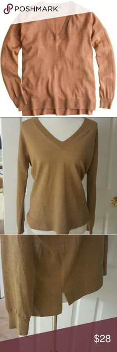 J. Crew Merino Wool Boyfriend Sweater J. Crew boyfriend sweater in merino wool 14 gauge knit. It's slightly oversize with a boxy silhouette, a deep V-neck, skinny sleeves and rib trim at neck, cuffs and hem. It pairs great with jeans or slacks and is in excellent condition. J. Crew Sweaters V-Necks