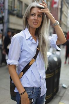 button down shirt over light casual jeans and cross body bag.Womens Fashion style icon. Sarah Harris. UK Vogue.