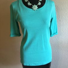 Forever 21 Teal Top Cleaning out my closet! Selling this never worn Forever 21 top, size L (fits like a M) It's a bright teal color that goes well with almost anything. Excellent condition! Forever 21 Tops