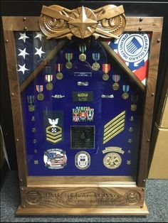 I was asked by a Coast Guard friend of mine to build this Walnut Shadowbox for one of his shipmates that was retiring. The Coxswain warfare device at the top along with the USCG Chiefs anchor and Coast Guard emblem artwork at the bottom were all . Woodworking Journal, Beer Caddy, Small Wooden Boxes, Home Blogs, Making Faces, Face Framing, Warfare, Shadow Box, Home Projects