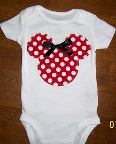 Minnie Mouse :) great idea for a baby, jst take a white one of thos and sew a minnie mouse design and a bow its so cute also!!!!