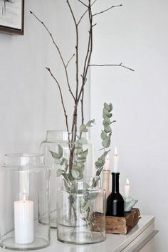 candles, eucalyptus and branches a perfectly styled sideboard glass jars and candles minimal scandinavian decor Bathroom Candles, Bathroom Counter Decor, Bathroom Countertops, Bathroom Interior, Kitchen Decor, Interior Livingroom, Apartment Interior, Bathroom Ideas, Kitchen Design