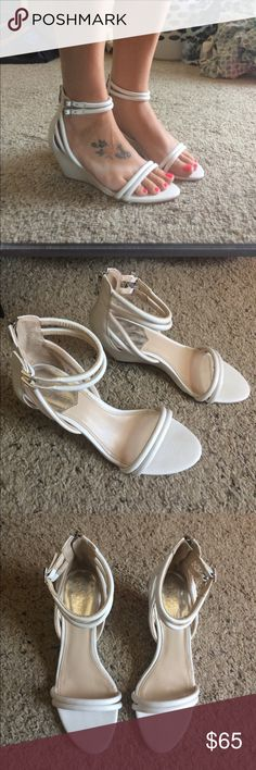 White wedges Worn once. No scuffs on any part of the shoe. Very low profile wedge. I don't have the box and the shoe doesn't show the size Vince Camuto Shoes Wedges