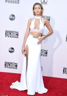 Wonder in white: Gigi Hadid showed plenty of skin as she arrived for the American Music Awards at the Microsoft Theater in Los Angeles on Sunday