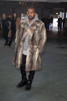 Pin for Later: 100 Reasons 2014 Was a Very Fashionable Year For the Kardashian-Jenner Crew We're including Kanye, because how can you not? This fur coat alone.