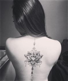 Lotus Flower Spine Tattoo Design