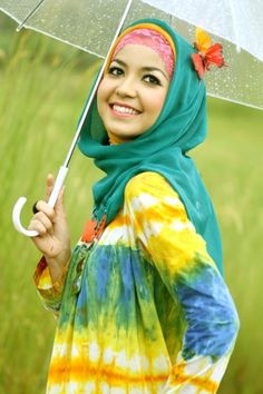 Butterfly on hijabi with umberella . Found on islamicfashion.tumblr.com via Tumblr