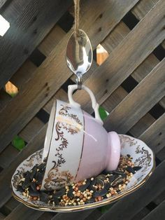 Items similar to Pink and Gold Royal Vale Teacup Bird Feeder with New Brunswick Souvenir Spoon, tea cup bird feeder, Royal Vale teacup, bird feeder, violets on Etsy Garden Bird Feeders, Silver Spoons, Perfect Gift For Her, Garden Ornaments, Upcycled Vintage, Teacup, Pink And Gold, Gifts For Mom, Garden Ideas