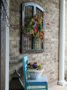 Vintage window frame, repainted old chair and flowers created this romantic porch decor #oldwindow #vintagedecoration