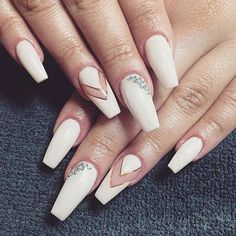 White Coffin Nails with diamonds. Coffin nails are more dominated by the nudes and whites, that is clearly seen in the example above. The diamond studded white and transparent coffin nail design is the trend setter.