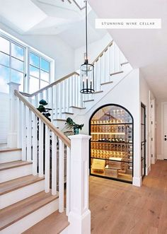 a dramatic wine cellar space under the stairs