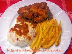 Κοτόπουλο κοκκινιστό με πατάτες τηγανιτές και ρύζι...