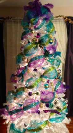 My peacock deco mesh turquoise and purple christmas tree