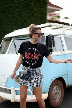 street style outfit + gingham print ruffle skirt + band tee + cross body chanel handbag + bohemian look with edge + summer outfit inspo Mode Outfits, Skirt Outfits, Casual Outfits, Fashion Outfits, Band Tee Outfits, Outfits With T Shirts, Fashion Clothes, Ladies Outfits, Fashion Skirts