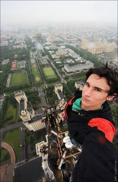 Russian rooftopping is a thing. A crazy thing. Kirill Oreshkin scales immense buildings and monuments, sans harnesses or safety equipment, just to take the most vertigo-inducing selfies you will ever see. Top Of The World, The Real World, Monuments, Perfect Camera, Best Selfies, Pose, Birds Eye View, Parkour, Daredevil